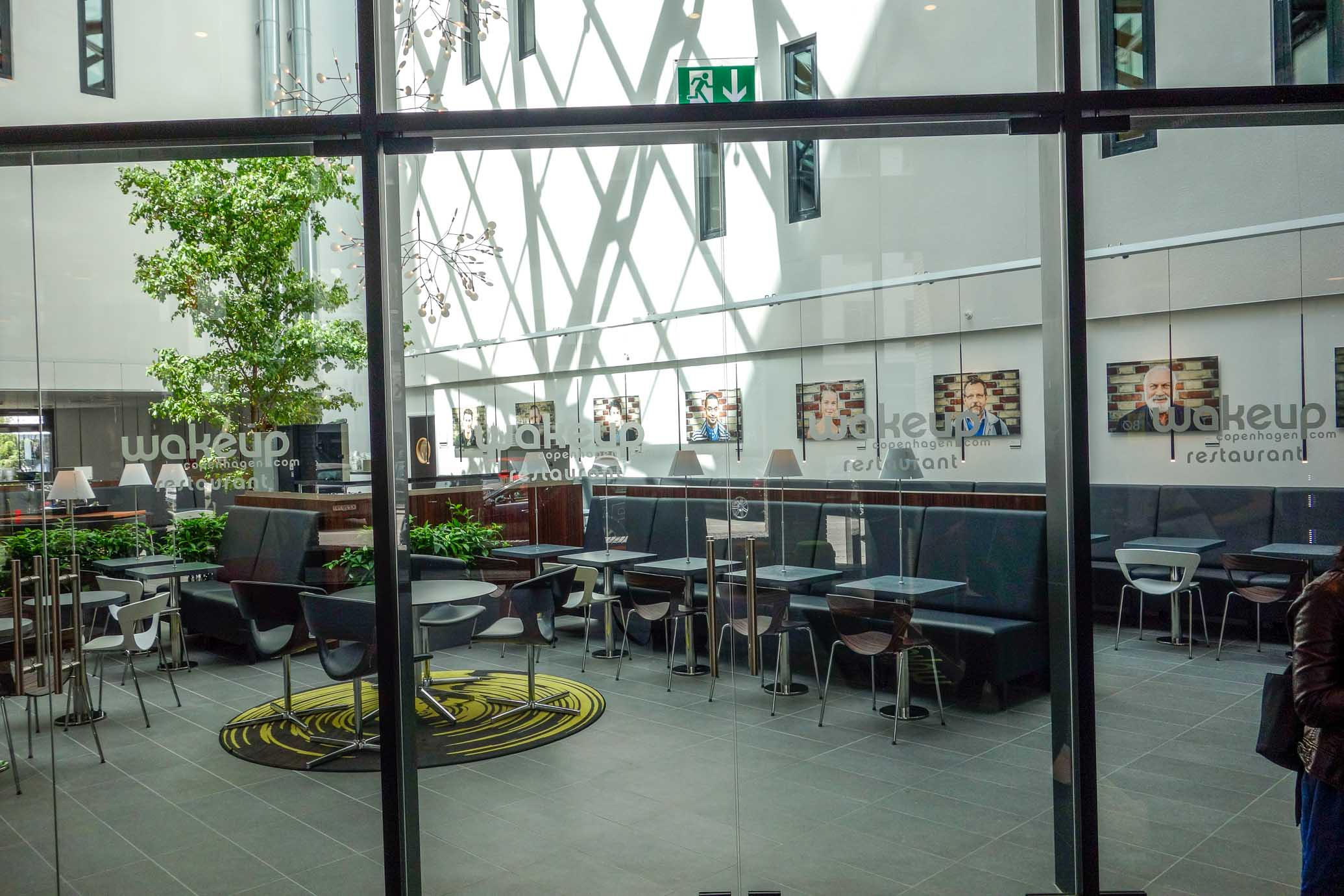 The breakfast area is separated from the Lobby by an entire wall of double glass doors